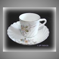 German Swirled Cup and Saucer Hand painted Floral and Raised Enamel