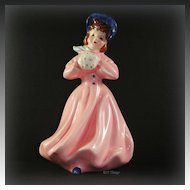 Florence Ceramics Company Young Girl Pat Pink Coat with Blue Hat Unusual Color