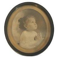 Antique Praying Child Sepia Tone Monochrome Photogragh Under Glass Oval Gilt Matte & Black Metal Frame