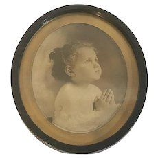 Antique Praying Child Sepia Tone Monochrome Photograph Under Glass Oval Gilt Matte & Black Metal Frame
