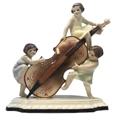 Art Deco Goldscheider Ceramic Figurine by Wilhelm Thomasch of Three Girls with Cello Vienna, Austria c. 1930s RARE!