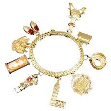 Large Vintage Travel Charm Bracelet 18k Gold with 9k 10k 14k and 18k gold charms