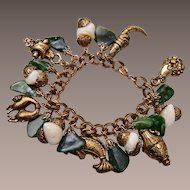 Fabulous Jade, Mother of Pearl and Gold Tone Charm Bracelet
