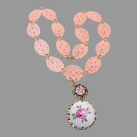Pink Lacy Plastic Necklace with Enameled Pendant