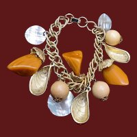 Shell, Mother of Pearl, and Plastic Charm Bracelet