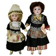 Pair of German Bisque Head Dolls in Dutch Regional Costume