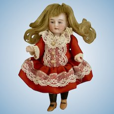 "4&1/2"" All Bisque Character Girl with Belton Head"