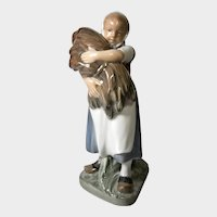 Royal Copenhagen Figurine: Girl Waking with Sheath of Straw by Christian Thomsen, No. 908