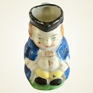 Miniature Toby jug of man with blue coat