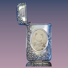 Hidden photo match safe with foliate edge design, sterling by Bassett Jewelry Co., c. 1898