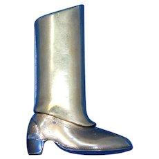 Figural cowboy boot match safe, brass, c. 1890