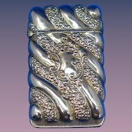 Foliate & diagonally fluted design match safe by Courvoisier-Wilcox Mfg. Co., Essex trademark, #105, c. 1900