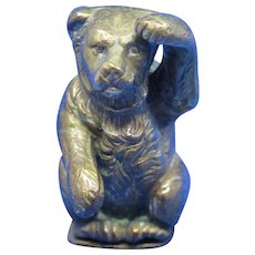 Figural bear with raised paw match safe, brass, c. 1895