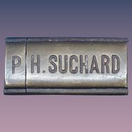 Figural P. H. Suchard chocolate candy bar match safe, brass, c. 1895