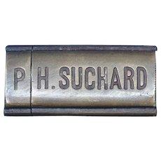 Figural P. H. Suchard chocolate candy bar match safe, brass, c. 1895