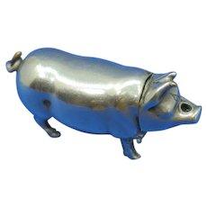 Figural pig match safe, go-to-bed vesta socket in nose, plated brass,  c. 1895
