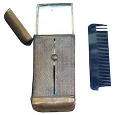 Unusual match safe with mirror and comb by Issac Raffel, brass, patented Dec. 27, 1887