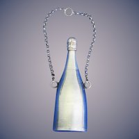Unusual figural champagne bottle match safe w/ attached chain, French, silver plated, c. 1900
