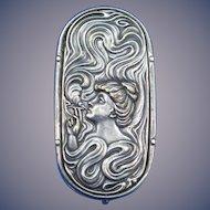 Lady smoking/horse racing motif match safe, nickel plated brass, c. 1900