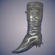 Cowgirl's riding boot match safe, vulcanite, c. 1895