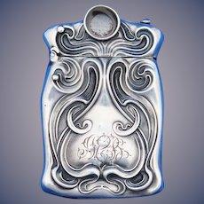 Art Nouveau swirl design match safe w/ cigar cutter, sterling by Unger Bros., c. 1900.