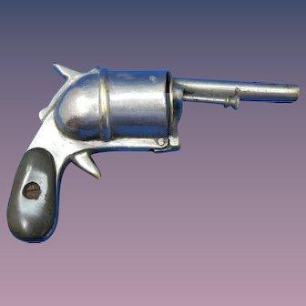 Figural pistol/revolver match safe, nickel plated brass, c. 1895