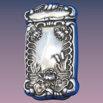 Water lily and cattail motif match safe, sterling, gold gilded interior, c. 1900