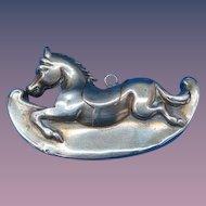 Figural rocking horse match safe, brass, c. 1895