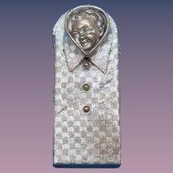 Figural baby's head in textured shirt match safe, c. 1895, brass