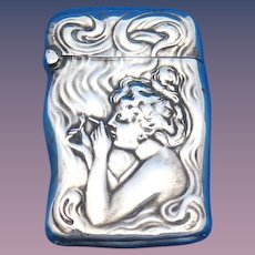 Art Nouveau young lady smoking cigarette motif match safe, sterling by Unger Bros., gold gilted interior, #8277, c. 1904