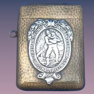 Fireman's Fund Insurance Company/Fireman & Child match safe, Christmas Greetings 1915, sterling on brass by Shreve & Co.