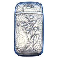 Lily of the valley motif with hammed background match safe, silver plated, c. 1900