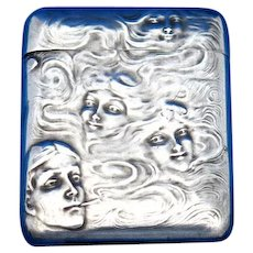 Man smoking dreaming of women, match safe, sterling by R. Blackinton, sold by Mermod & Jaccard, #647, c. 1900