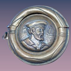 "Figural life preserver match safe, image of sailor from H.M.S. Hero, Players ""Senior Service"" Cigarettes trademark, brass, c. 1905, NOT A REPRODUCTION"
