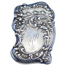 Slant top, scroll motif match safe, sterling by Unger Bros. 1900