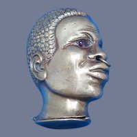 Figural African head match safe with glass eyes, brass, c. 1895