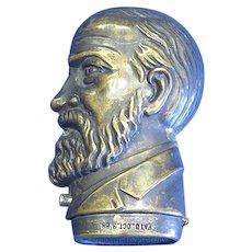 Figural President Benjamin Harrison portrait match safe, brass by Simon Zinn, Pat. Oct. 8. 1888