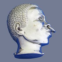 Figural Negro head match safe with original glass eyes, nickel plated brass, c. 1895