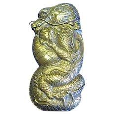 Figural dragon clutching trama (ball of wisdom), match safe, Japanese, brass, c. 1890