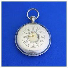 Figural demi hunter pocket watch shaped match safe, enameled on nickel plated brass, c. 1900