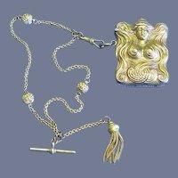 Art Nouveau female image match safe, elaborate chain, brass, c. 1895