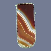 Banded agate match safe with brass filigree edge trim, c. 1895