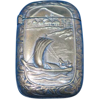 Japanese match safe, boat with village and Mt Fuji, brass, c. 1895