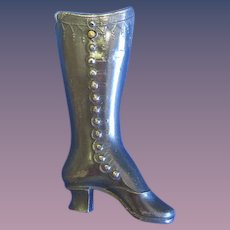 Figural lady's boot with cigar cutter match safe, gun metal finish, c. 1895, unusual