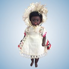 Exquisite and Rare Ebony Complexioned German All Bisque Doll With Bare Feet By Kestner.