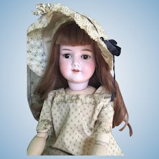 """Antique 24"""" Armand Marseille 390n German Bisque Head Doll in Antique clothing."""