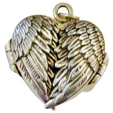 Fanciful Feathered Wings Locket in Sterling Silver