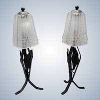 Unique pair French wrought iron Art Deco table lamps with mould pressed decorated glass shades.