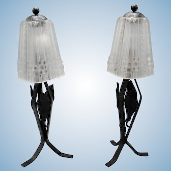 Unique pair of French wrought iron Art Deco table lamps with mould pressed glass shades decorated with geometric figures in relief.