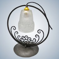 Great French wrought iron desk/night lamp with decorated pressed glass shade. (ca 1930)